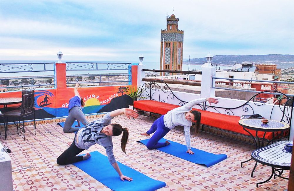 surf camp in tamraght with Yoga classes