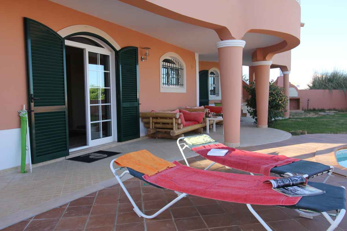Relax at the pool in the Luz surf villa